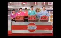 """<p>Before the Big Sweep begins, contestants compete in a number of events such as """"mini sweeps,"""" quizzes, and additional<a href=""""https://gameshows.fandom.com/wiki/Supermarket_Sweep"""" rel=""""nofollow noopener"""" target=""""_blank"""" data-ylk=""""slk:games"""" class=""""link rapid-noclick-resp""""> games</a>, like the round robin, that can result in them earning both <a href=""""https://www.youtube.com/watch?v=DLeVYtsQyhE&feature=youtu.be"""" rel=""""nofollow noopener"""" target=""""_blank"""" data-ylk=""""slk:extra money and time on the clock"""" class=""""link rapid-noclick-resp"""">extra money and time on the clock</a> for their sweep. These occur at various points in the segments.</p>"""