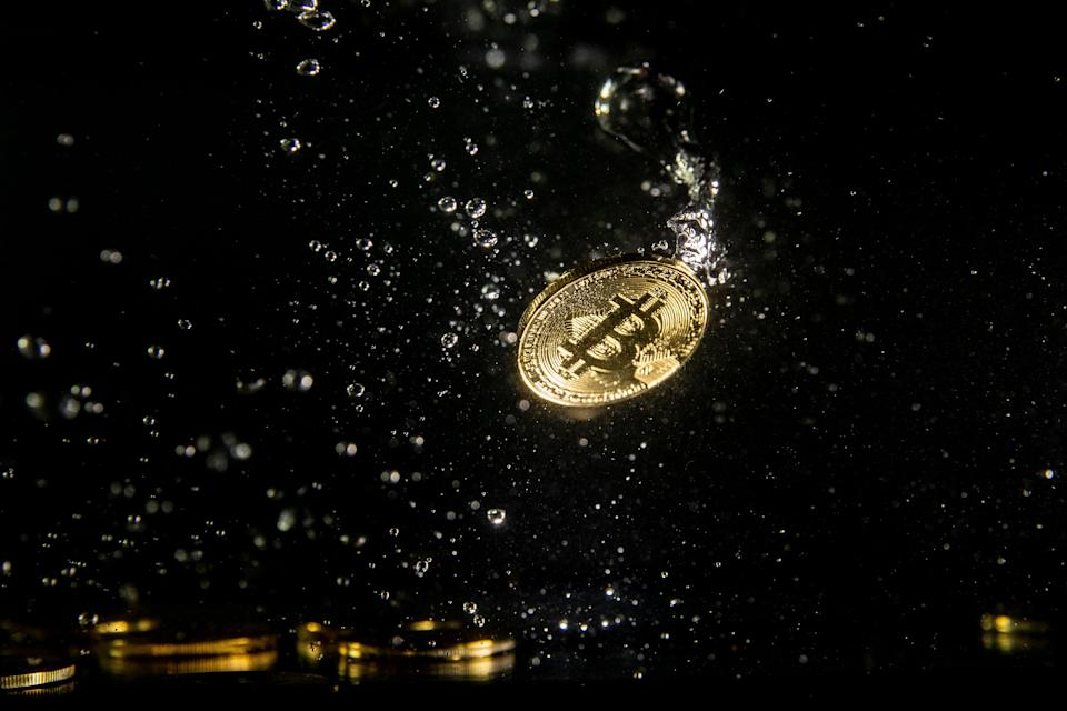 <p>A visual representation of the digital currency Bitcoin sinking into water on 15 August, 2018 in London, England</p> (Getty Images)