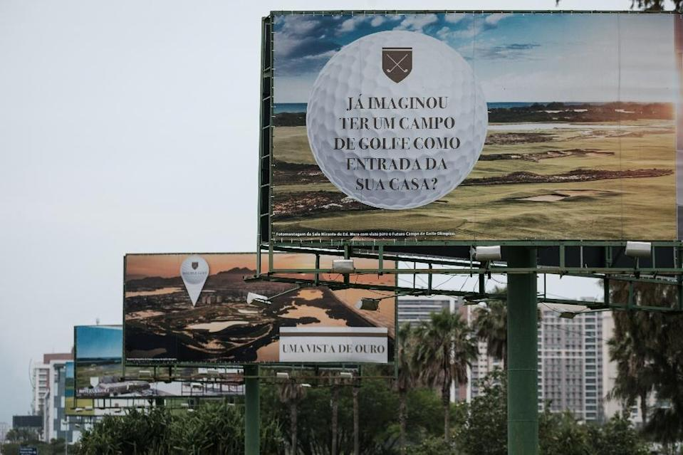 Advertisement boards for the new apartments built next to the Olympic golf course, created and used for the Rio 2016 Olympic Games and now run by the Brazilian Golf Confederation for the public, are seen November 23, 2016 (AFP Photo/Yasuyoshi Chiba)