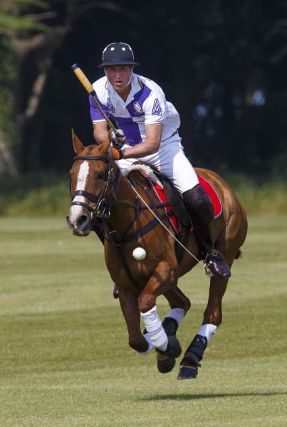 Prince William, the Duke of Cambridge in action during The Jerudong Trophy at Cirencester Park Polo Club in Gloucestershire Sunday July 14, 2013. Many in the British press have predicted that the first child of the prince and the Duchess of Cambridge, formerly known as Kate Middleton, is expected to arrive on Sunday but the prince was enjoying a game of polo against his brother Prince Harry at a charity event. (AP Photo/ Chris Ison, PA) UNITED KINGDOM OUT - NO SALES - NO ARCHIVES