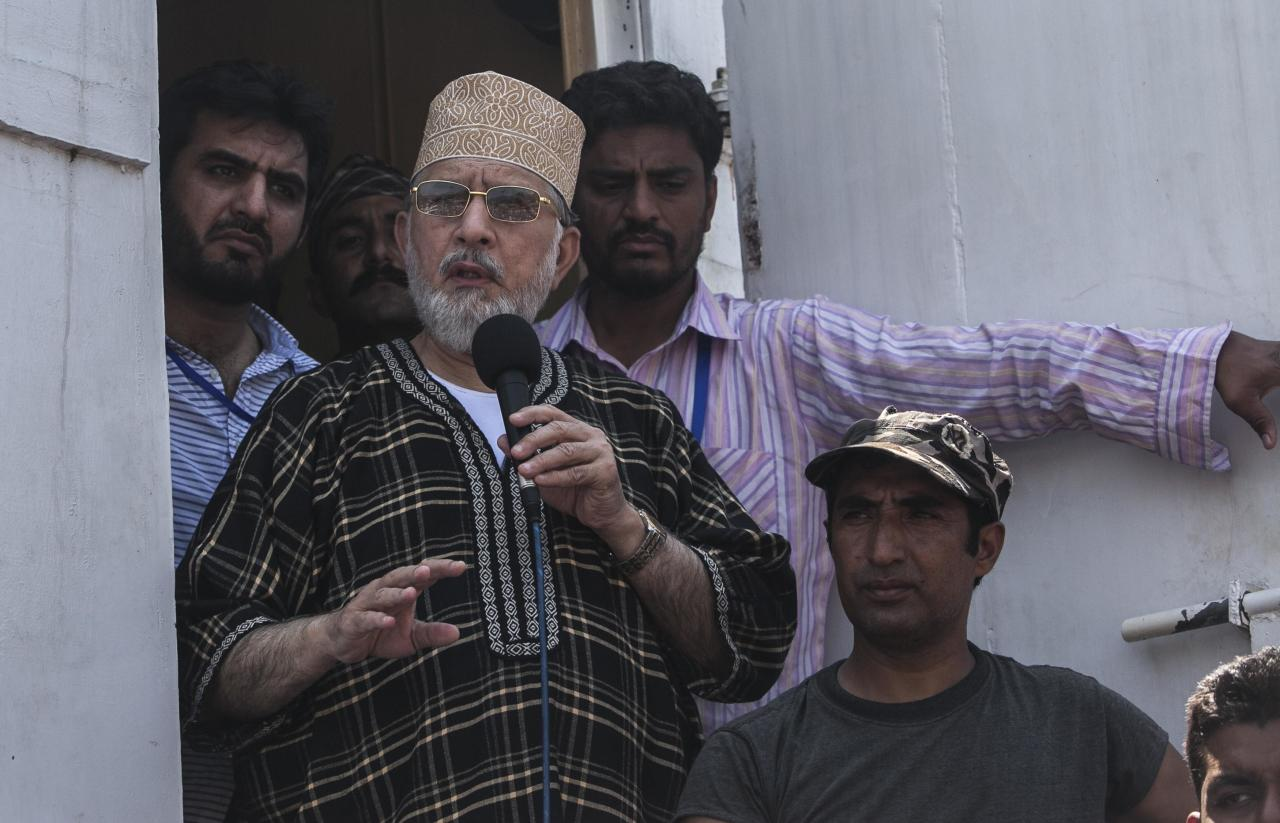 Tahir ul-Qadri, Sufi cleric and leader of political party Pakistan Awami Tehreek (PAT),addresses supporters during the Revolution March in Islamabad August 31, 2014. Thousands of protesters massed outside the residence of Pakistani Prime Minister Nawaz Sharif on Saturday to demand he step down, after efforts to find a negotiated solution to the country's political crisis failed.Pakistan has been gripped by unrest for more than two weeks, with protest leaders Imran Khan and Tahir ul-Qadri saying they will not back back down unless Prime Minister Nawaz Sharif resigns. On Saturday Sharif once again said he would not go. REUTERS/Akhtar Soomro (PAKISTAN - Tags: POLITICS CIVIL UNREST)