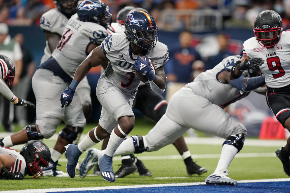 UTSA running back Sincere McCormick (3) runs for a touchdown against Lamar during the first half of an NCAA college football game Saturday, Sept. 11, 2021, in San Antonio. (AP Photo/Eric Gay)
