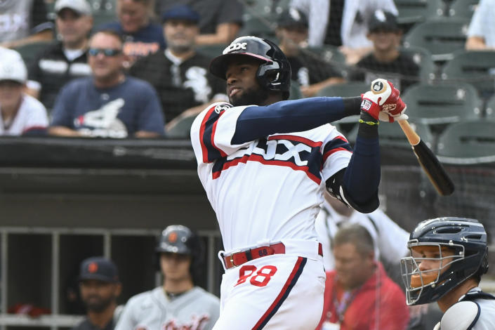 Chicago White Sox's Luis Robert hits a home run during the first inning of a baseball game against the Detroit Tigers, Sunday, Oct. 3, 2021, in Chicago. (AP Photo/Matt Marton)