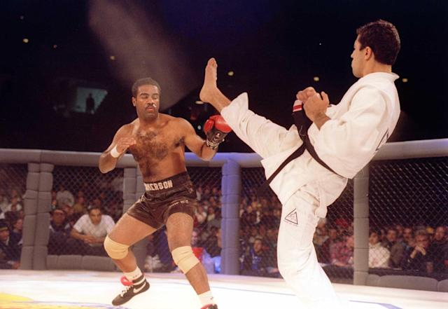 Jiu-Jitsu black belt Royce Gracie kicks at cruiserweight boxer Art Jimmerson during the Ultimate Fighter Championships in Denver, Colorado on Nov. 12, 1993. (Markus Boes/Getty Images)