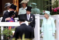 Britain's Queen Elizabeth II, right, talks to Frankie Dettori, left and trainer John Gosden, background left , during day five of of the Royal Ascot horserace meeting, at Ascot Racecourse, in Ascot, England, Saturday June 19, 2021. (David Davies/PA via AP)