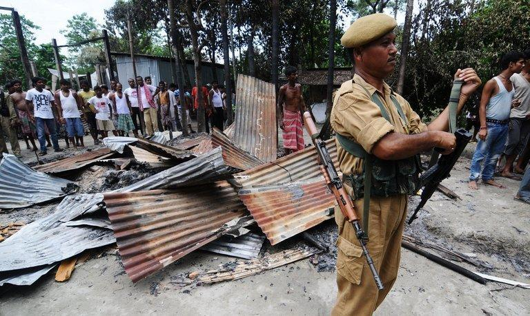 A house burnt by rioters in Kharabari Charak Math village,  170km from Guwahati on August 29, 2012
