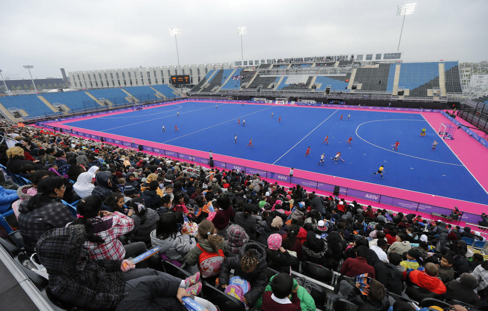 Spectators watch Britain play South Korea during the women's International Invitational Hockey Tournament at the Riverbank Arena on the Olympic Park in London May 2, 2012. REUTERS/Eddie Keogh