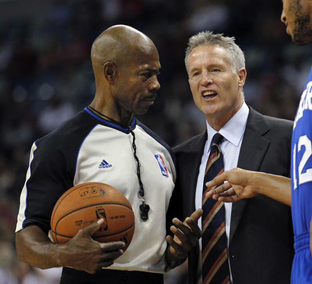 Philadelphia 76ers head coach Brett Brown challenges a call by the official in the first half of an NBA basketball game against the New Orleans Pelicans in New Orleans, Saturday, Nov. 16, 2013. (AP Photo/Gerald Herbert)