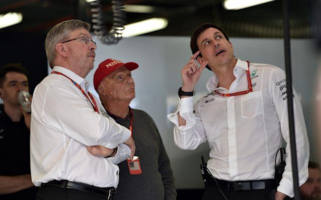 <span>Toto Wolff (right) withNiki Lauda (centre) and Ross Brawn (left)</span> <span>Credit: AFP </span>