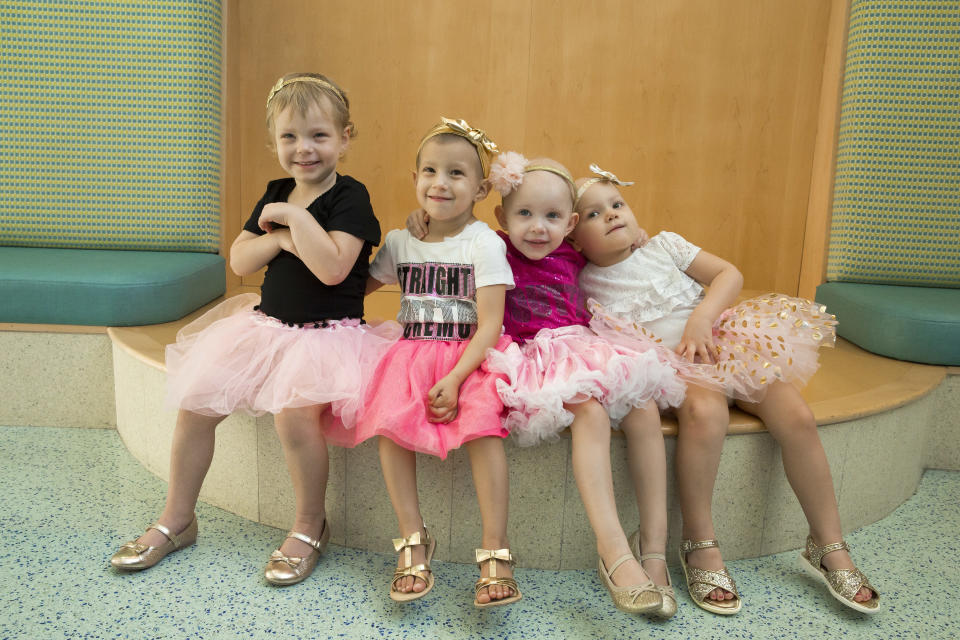 """Celebrating National Childhood Cancer Awareness Month and """"Tutu Tuesday,"""" McKinley, Chloe, Lauren, and Ava in the lobby of the hospital in 2016. (Photo: Johns Hopkins All Children's Hospital)."""