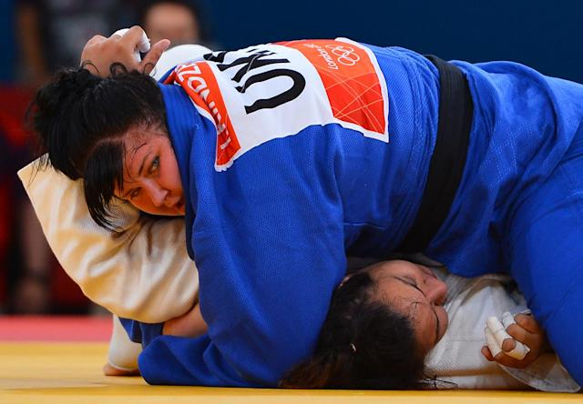 Turkey's Gulsah Kocaturk (white) competes with Ukraine's Iryna Kindzerska (blue) during their women's +78kg judo contest match of the London 2012 Olympic Games on August 3, 2012 at the ExCel arena in London. AFP PHOTO / MIGUEL MEDINAMIGUEL MEDINA/AFP/GettyImages