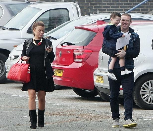 Wayne Rooney with his wife Coleen and child.