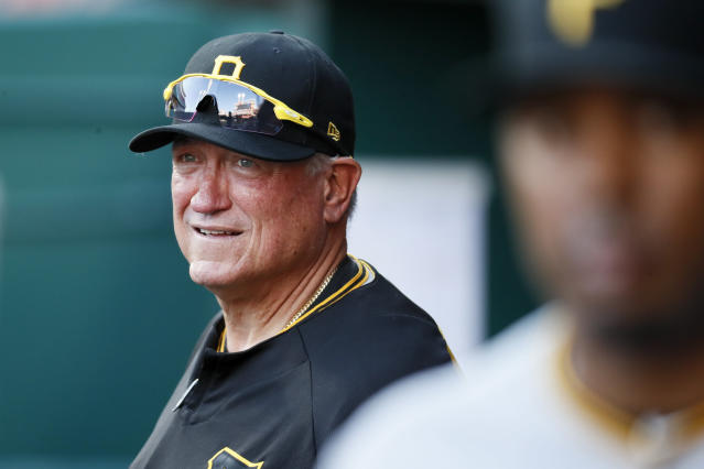 Pittsburgh Pirates manager Clint Hurdle watches from the dugout during the first inning of the team's baseball game against the Cincinnati Reds, Wednesday, May 23, 2018, in Cincinnati. (AP Photo/John Minchillo)