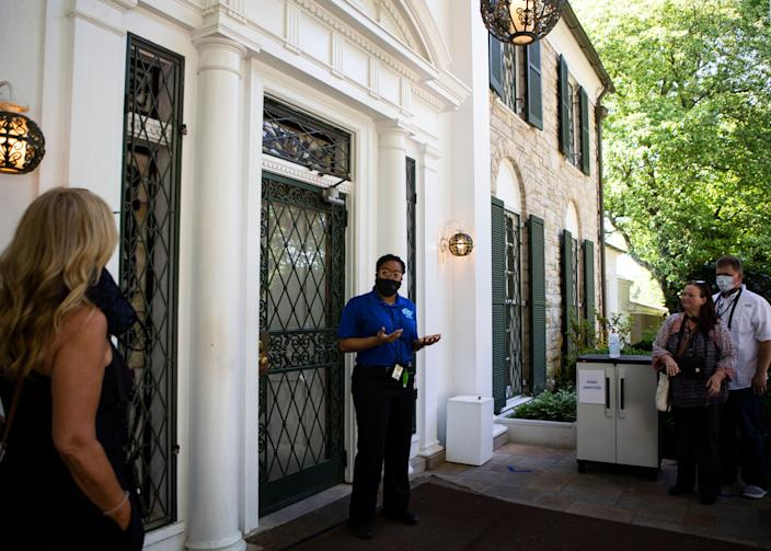 Kristyn Walker welcomes tourists into the mansion at Graceland in Memphis on Thursday, May 21, 2020. Graceland reopened for the first time since closing March 20 amid the coronavirus pandemic.
