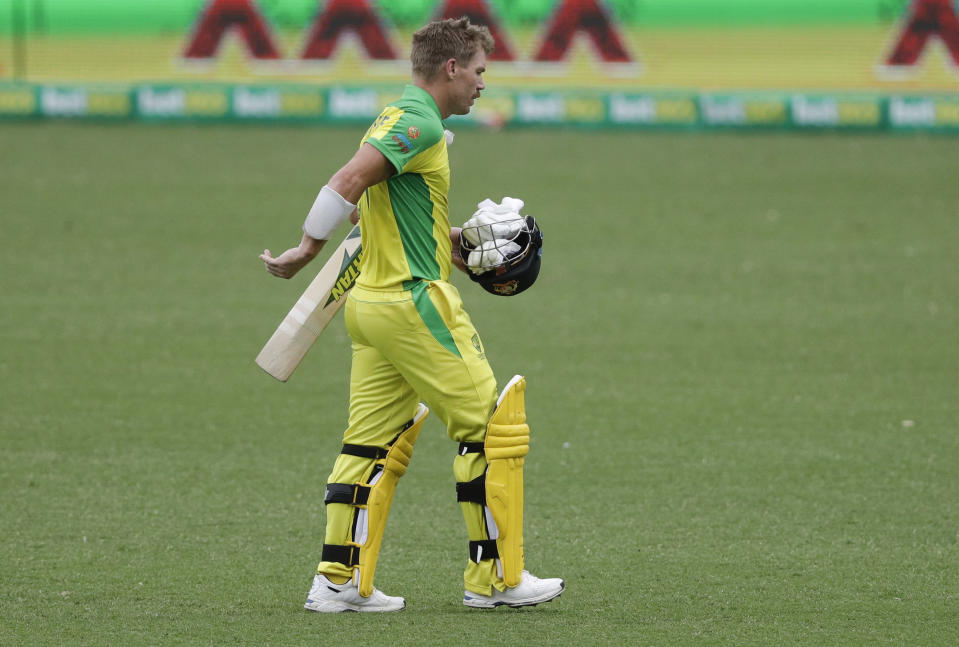 Australia's David Warner walks from the field after he was run out for 83 runs during the one day international cricket match between India and Australia at the Sydney Cricket Ground in Sydney, Australia, Sunday, Nov. 29, 2020. (AP Photo/Rick Rycroft)