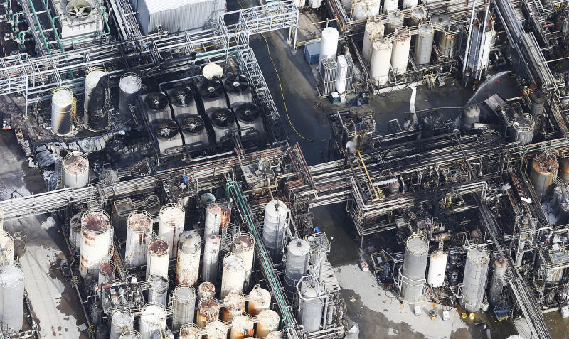 This aerial photo shows firefighters spraying water on a fire at the KMCO chemical plant on Tuesday, April 2, 2019 in Crosby, Texas. Authorities say the fire has been contained at the plant near Houston and they have lifted an order that instructed residents within a 1-mile (1.6 kilometers) radius of the facility to stay indoors. (Elizabeth Conley/Houston Chronicle via AP)