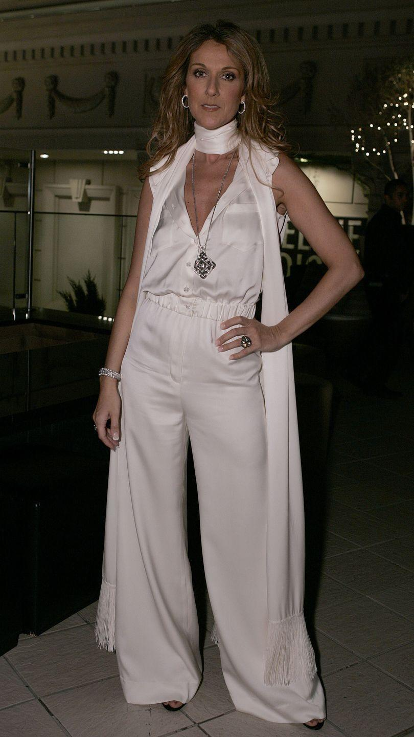 <p>Always a trendsetter, Dion sported the monochromatic look in Las Vegas before it was cool. Her silky white jumpsuit and scarf looks effortless, and her jewelry choices add polish.</p>