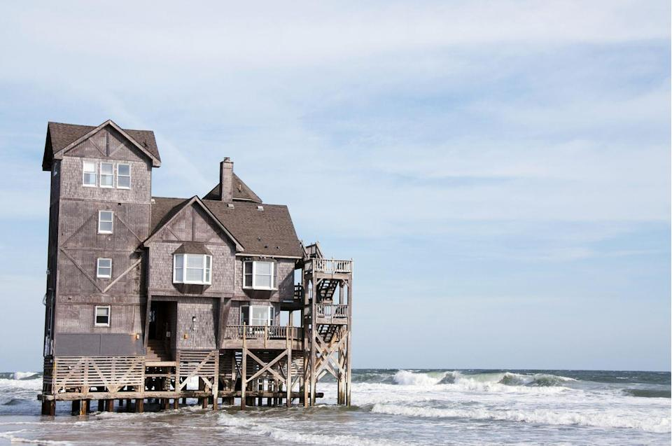 """<p>Does this oceanfront vacation home look familiar to you? If it does, you might have seen it in the 2008 Nicholas Sparks film starring Richard Gere and Diane Lane, <em>Nights in Rodanthe</em>. The <a href=""""http://www.sunrealtync.com/inn-rodanthe-hatteras-islands-most-celebrated-vacation-rental"""" rel=""""nofollow noopener"""" target=""""_blank"""" data-ylk=""""slk:Inn at Rodanthe"""" class=""""link rapid-noclick-resp"""">Inn at Rodanthe</a> was built in the 1980s, when it originally stood 400 feet from the Atlantic Ocean. But the water crept ever closer and the home was put in great danger, so it was moved to this location in 2010, where it's now available to rent. </p>"""