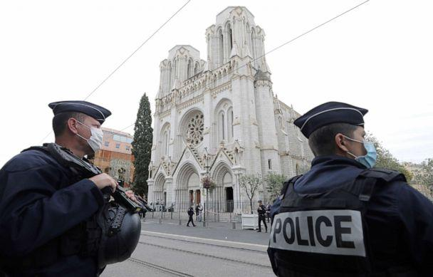 PHOTO: Police officers stand guard near Notre Dame church in Nice, southern France, Oct. 29, 2020. (Eric Gaillard/AP)
