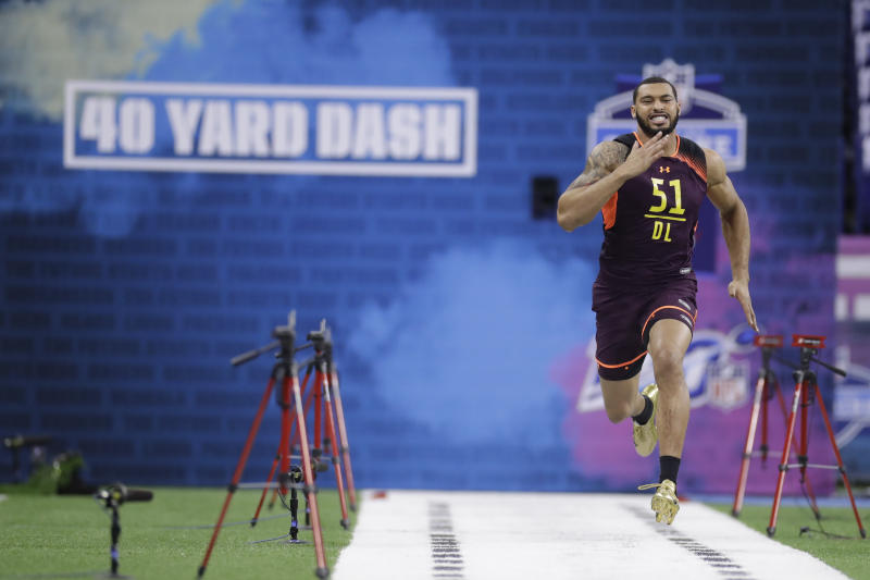 Defensive lineman Montez Sweat, a first-round pick of the Washington Redskins in 2019, runs the 40-yard dash during the NFL scouting combine. (AP Photo/Darron Cummings)