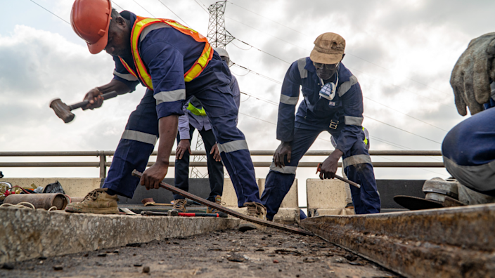 Workers doing repairs on the Third Mainland Bridge in Lagos, Nigeria