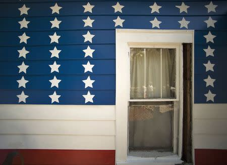 Stars and stripes are painted on the siding around a window of a 110-year-old house owned by Brent and Catherine Greer in Bradenton, Florida, June 6, 2014. REUTERS/Steve Nesius