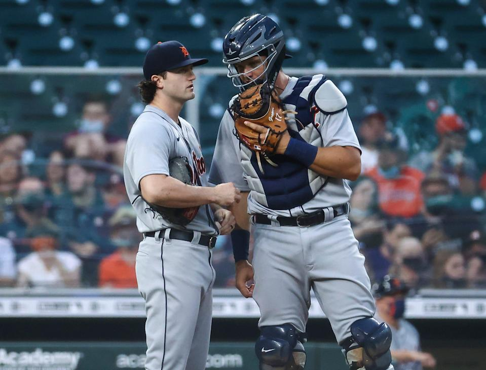 Detroit Tigers starting pitcher Casey Mize (12) and catcher Grayson Greiner (17) talk on the mound during the first inning against the Houston Astros April 12, 2021 at Minute Maid Park.