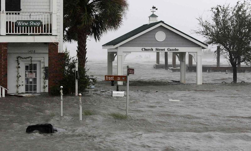 High winds and water surround buildings as Hurricane Florence hits Front Street in downtown Swansboro, North Carolina on Friday.