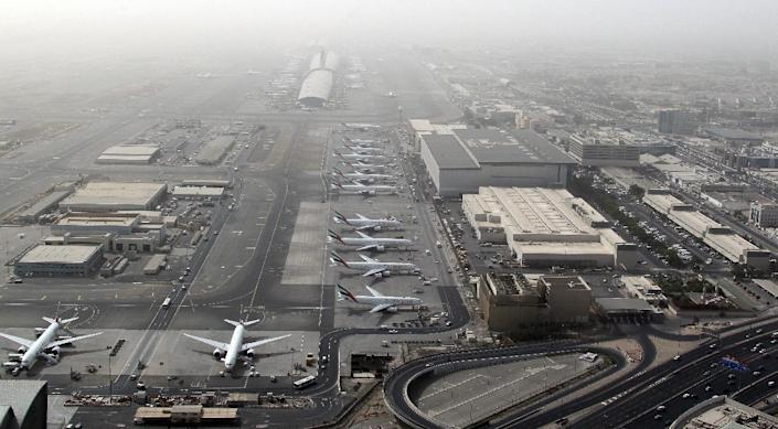 An aerial view shows planes parked at Dubai international airport, home to the national carrier Emirates Airways, on May 27, 2012 (AFP Photo/Karim Sahib)