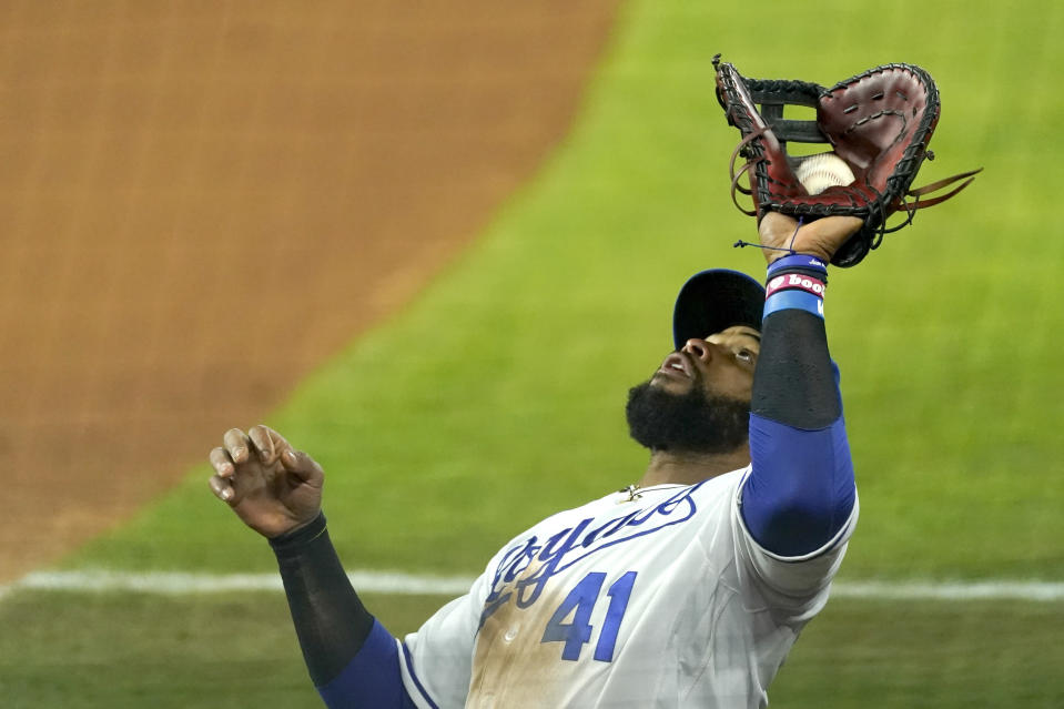 Kansas City Royals first baseman Carlos Santana catches a fly foul ball for an out against Tampa Bay Rays' Yandy Diaz during the seventh inning of a baseball game Monday, April 19, 2021, in Kansas City, Mo. (AP Photo/Charlie Riedel)