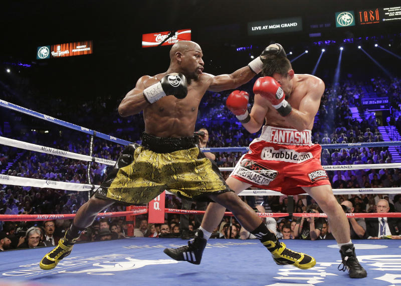 Floyd Mayweather Jr. throws jabs at Robert Guerrero in the third round during a WBC welterweight title fight, Saturday, May 4, 2013, in Las Vegas. Mayweather won by unanimous decision. (AP Photo/Rick Bowmer)