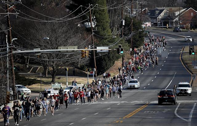 <p>Students from Montgomery Blair High School march down Colesville Road in support of gun reform legislation Feb. 21, 2018 in Silver Spring, Maryland. In the wake of last week's shooting in Parkland, Florida, where 17 people were killed, the students planned to take public transportation to the U.S. Capitol to hold a rally demanding legislation to curb gun violence in schools. (Photo: Win McNamee/Getty Images) </p>