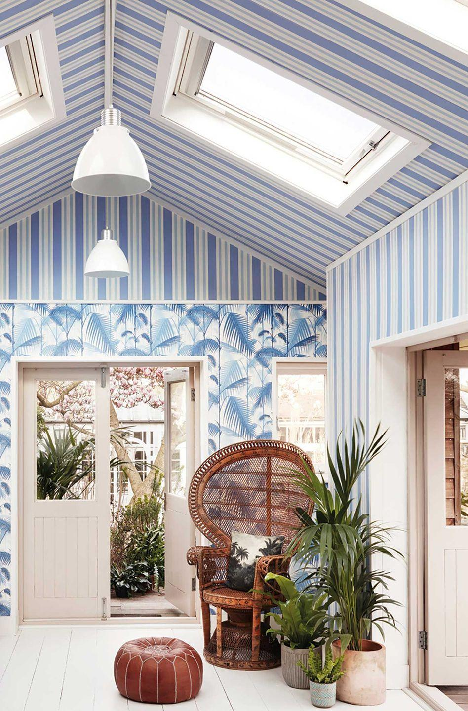 """<p>Often given over to interesting feature lights, or simply painted white, your ceilings are an ideal spot to play with pattern and colour. Even using contrasting wallpaper to the rest of the room, like the neat stripes offset by the botanical print used here can make for an interesting focal point. </p><p>Pictured: <a href=""""https://www.cole-and-son.com/en/products/polo-stripe?v=1323"""" rel=""""nofollow noopener"""" target=""""_blank"""" data-ylk=""""slk:Polo Stripe"""" class=""""link rapid-noclick-resp"""">Polo Stripe</a>, Cole & Son</p>"""
