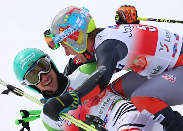 Ted Ligety, of the United States, right, winner of an Alpine Ski men's giant slalom, celebrates with third-placed Felix Neureuther, of Germany, at the World Cup finals, in Lenzerheide, Switzerland, Saturday, March 15, 2013. (AP Photo/Armando Trovati)