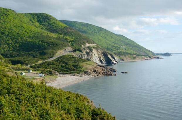 The Cabot Trail is a popular destination for Nova Scotians and tourists alike. Destination Cape Breton and the province's hotel association have written to Premier Iain Rankin, asking him to set firm dates in the province's reopening plan. (Destination Cape Breton - image credit)