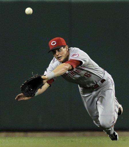 Cincinnati Reds center fielder Drew Stubbs dives but cannot reach a ball hit by St. Louis Cardinals' Carlos Beltran for a single during the third inning of a baseball game Tuesday, April 17, 2012, in St. Louis. (AP Photo/Jeff Roberson)