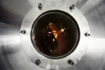 View through a window of the interior of an ultra-high vacuum reactor where titanium oxide (TiO2) nanotubes are decorated with cobalt oxide (CoO) nanoparticles. (Christian Fleury, INRS) (CNW Group/Institut national de la recherche scientifique (INRS))