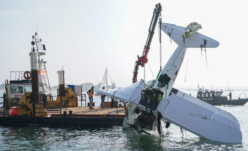 The bi-plane is lifted from Poole harbour following the crash (Andrew Matthews/PA) (PA Wire)