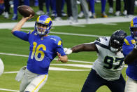 Los Angeles Rams quarterback Jared Goff (16) throws under pressure from Seattle Seahawks defensive tackle Poona Ford (97) during the first half of an NFL football game Sunday, Nov. 15, 2020, in Inglewood, Calif. (AP Photo/Ashley Landis)
