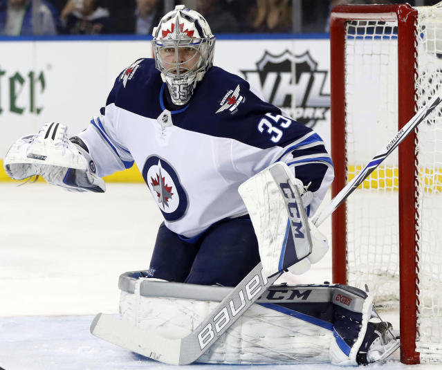 FILE - In this March 6, 2018, file photo, Winnipeg Jets goaltender Steve Mason works in the net during the second period of an NHL hockey game against the New York Rangers in New York. A person with direct knowledge of the move says Minnesota Wild forward Tyler Ennis and now Montreal Canadiens goaltender Steve Mason were placed on buyout waivers. The person spoke to The Associated Press on condition of anonymity Saturday, June 30, 2018, because the transactions had not been announced. Each player went on unconditional waivers at noon with the purpose of his club buying out his contract.(AP Photo/Kathy Willens, File)