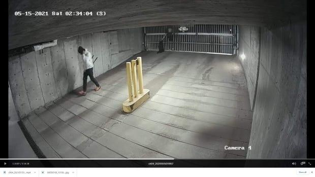 Security footage from a Vancouver condo building on East. 16th Avenue shows a thief entering a parkade shortly after he cut and slipped through a metal gate. (Submitted by Diane Selkirk - image credit)