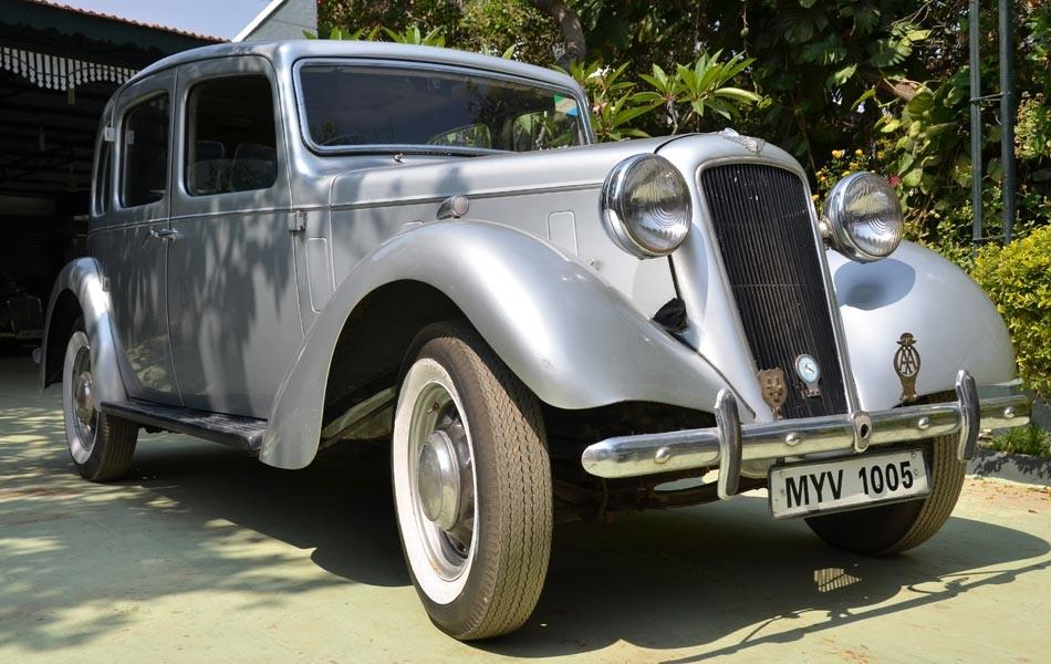 "<b>Car:</b> Austin 14<br><b>Year:</b> 1939 <br><b>Owner:</b> Cheshire Homes India (King and Partridge oversaw the sale, they were solicitors to the estate of McGucken, who originally owned the house)<br><b>Story:</b> Sulaiman moved from Coimbatore to Bangalore and started his career as a junior engineer. He bought his first car an Austin 14 (1939) for Rs 4000 in 1979. After buying the car he drove the car to 2 Stroke Motors. ""They were known for their painting and body shop work. It was restored in no time and I was bitten by the bug."""