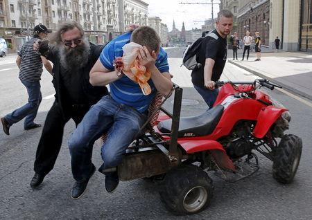 Anti-gay protesters attack gay rights activist during LGBT community rally in central Moscow