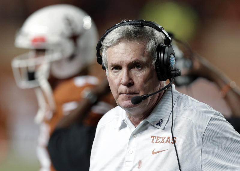 FILE - In this Sept. 21, 2013, file photo, Texas coach Mack Brown, right, watches from the side lines during the second half of an NCAA college football game against Kansas State in Austin, Texas. Brown has stepped down as coach and that the Alamo Bowl against Oregon on Dec. 30 will be his last game with the Longhorns, the school announced Saturday, Dec. 14, 2013. (AP Photo/ Eric Gay)