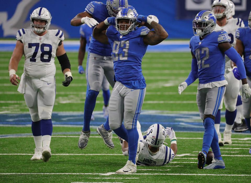 Lions defensive end Da'Shawn Hand celebrates his tackle on Colts running back Nyheim Hines during the first half on Sunday, Nov. 1, 2020, at Ford Field.