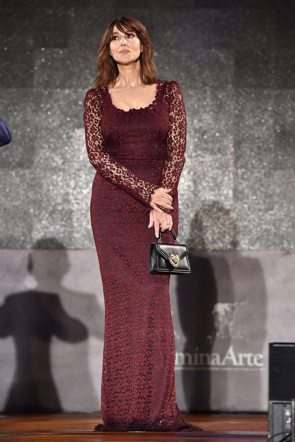 <p><strong>18 July </strong>Monica Bellucci looked elegant in a burgundy lace Dolce & Gabbana dress and Devotion bag at the Taormina Film Festival in Italy, where she was a guest of honour alongside Domenico Dolce and Stefano Gabbana. </p>