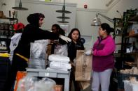 FILE PHOTO: Employees laid off from Farley's East cafe, that closed due to the financial crisis caused by the coronavirus disease (COVID-19), collect food items at the cafe in Oakland, California