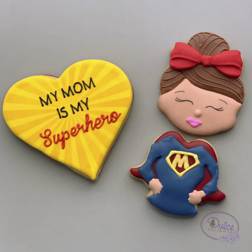"""<p>Mothers are amazing superheroes who can do it all — including the baker/mom from Dulce Delights who creates these <a href=""""https://www.dulce-delights.com/product/superhero-mom-cookie-set/"""" rel=""""nofollow noopener"""" target=""""_blank"""" data-ylk=""""slk:adorable sugar cookies"""" class=""""link rapid-noclick-resp"""">adorable sugar cookies</a> that taste just as good as they look.</p> <p><strong>$18, <a href=""""https://www.dulce-delights.com/product/superhero-mom-cookie-set/"""" rel=""""nofollow noopener"""" target=""""_blank"""" data-ylk=""""slk:dulcedelights.com"""" class=""""link rapid-noclick-resp"""">dulcedelights.com</a></strong></p>"""