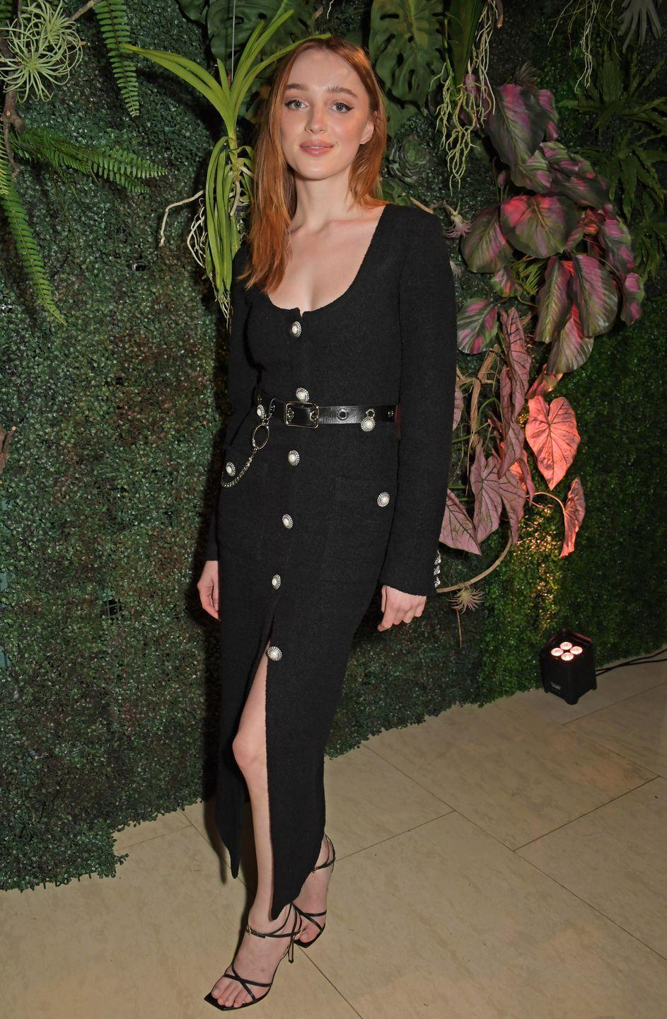 <p>The Bridgerton star wore a black midi dress embellished with pearl buttons, a black leather belt and black strappy heels to a fundraiser in London. The actor kept her make-up simple and her red hair styled straight. </p>