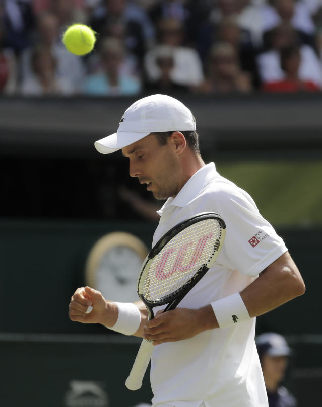 Spain's Roberto Bautista Agut celebrates winning a point in a men's singles semifinal match against Serbia's Novak Djokovic on day eleven of the Wimbledon Tennis Championships in London, Friday, July 12, 2019. (AP Photo/Ben Curtis)